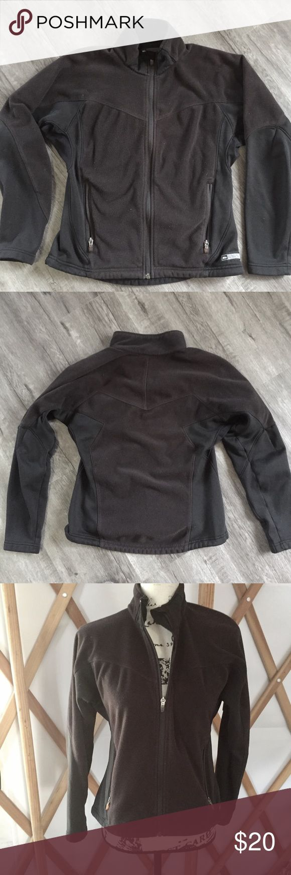 Black REI Fleece Jacket Very gently used black Women's Small REI polartech fleece jacket. The front and back of the body are fleece and the sides are soft stretch fabric for a flattering cut.  The armpits have slightly thinner fabric to help with temperature regulation.  Full zip with 2 zippered external pockets and two interior pockets.  The bottom hem also has a drawstring closure. Good used condition (4/5). REI Jackets & Coats