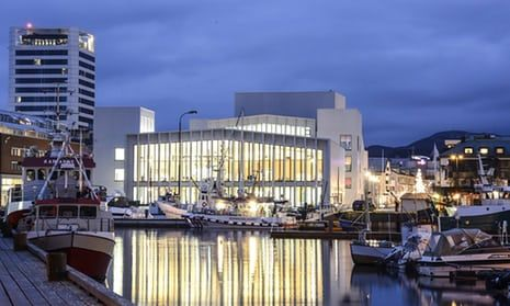 Dusk view of an illuminated Stormen library and cultural centre in Bodø, Norway