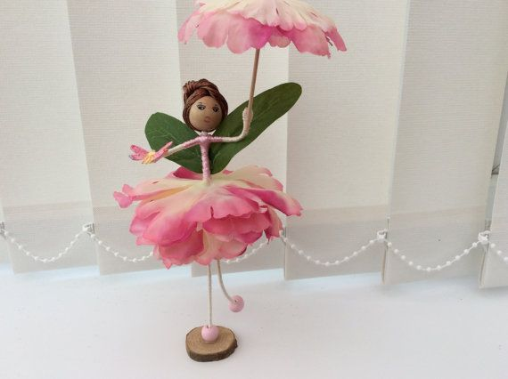 Meet Ailidh! Ailidh is a Flower Fairy And she is wearing a silky pink bodice which complements her pink peony skirt. Ailidh is holding a parasol which matches her outfit and a butterfly has come to rest on her other hand! And who knew Fairys had such fabulous accessories✨ Ailidh can move her arms and legs so you can change her pose too! Ailidh has on pink shoes and she rests on a small wooden stand. Ailidh is unique and designed and handmade under Caledonian Skys