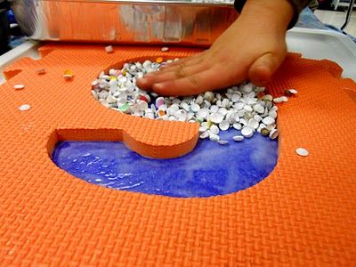 Paint on glue then use punches or even confetti. Lay down big foam number or letter then peel off