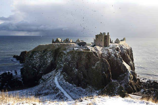 Dunnottar Castle, Aberdeenshire : The ruins of this 15th century castle sit atop a natural peninsula that juts out over the North Sea, but it's probably still less drafty than my apartment