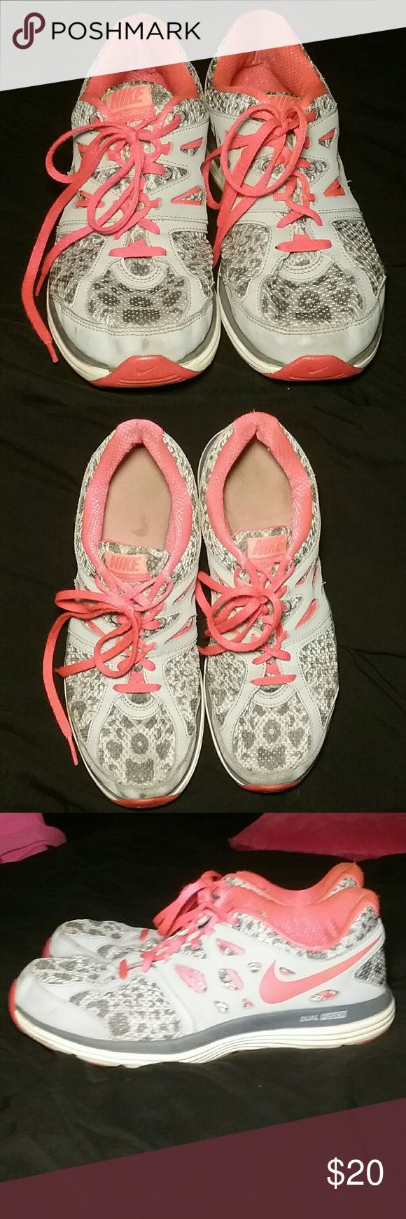 Grey and Coral Cheetah Nikes In used condition. Very very cute. No tears, just usual wear☺ color is an orangish pink. Nike Shoes Sneakers