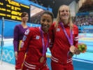 Emilie Heymans and Jennifer Abel celebrate their bronze medals in the 3-metre synchronized springboard final at the London Olympics. (July 29, 2012)