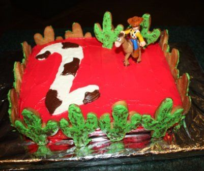 Homemade Cowboy theme cake with cookie cactuses around the edge...