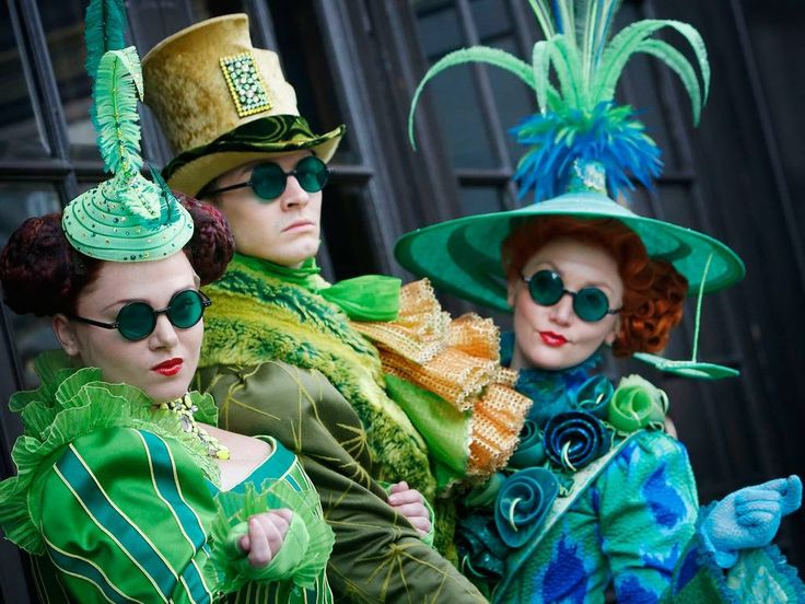 Wicked cast members (left to right) Lauren Ellis-Steele, Tom Mather and Victoria Farley dresses in Susan Hilfertyís Tony Award winning Emerald City costumes