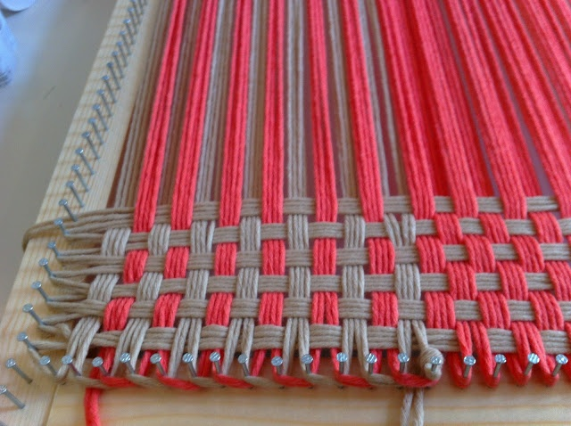Weaving with yarn...cool idea to get rid of ends of skeins...must ask DH to make me a frame!