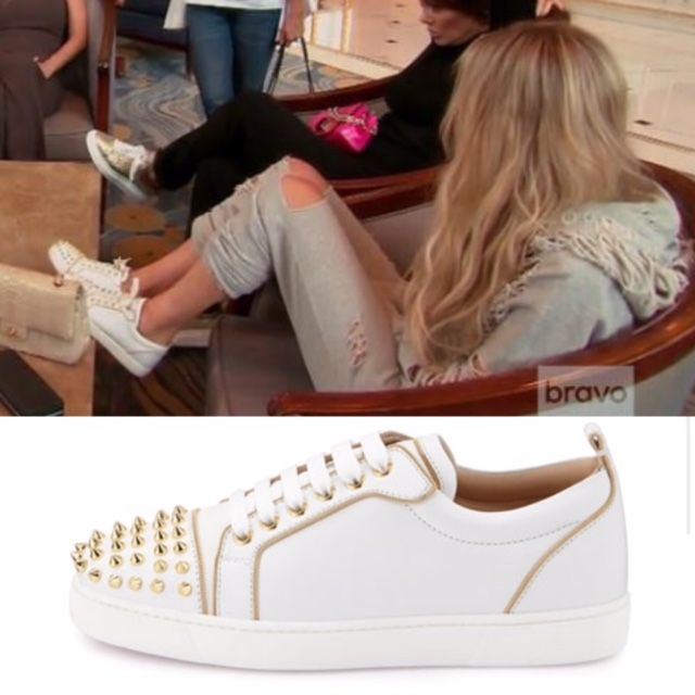 Dorit Kemsley's White Studded Sneakers Shopping in Hong Kong http://www.bigblondehair.com/real-housewives/rhobh/dorit-kemsley-fashion-rhobh/dorit-kemsleys-white-sneakers-with-gold-studs/ Christian Louboutin Rush Spiked Sneakers