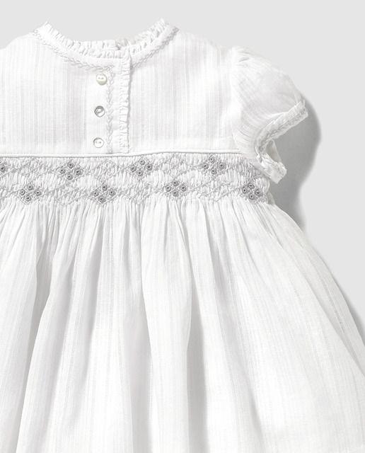 Vestido de bebé niña Dulces blanco con nido de abeja