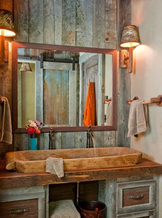 Rustic bathroom. I love the colors in the wood, and esp. the sliding door seen in the reflection.