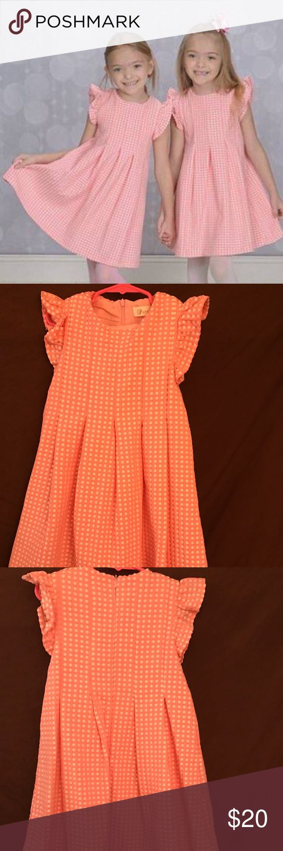 "Pink with white dots dress. Very pretty girls formal dress. We just used this to take Easter pictures. They were worn for maybe 10 minutes. My daughters were a size 6/7  and are 49 inches long. the dress fit very nicely. It's about an inch above their knees. The length of the dress from the shoulders measures 25"" Dresses Formal"