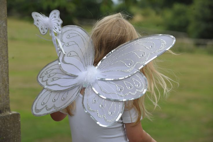 Silver White Wings and Wand Set ~  Those fairies are a competitive lot, all wanting to have the most spectacular wings...and they don't come any more spectacular than these three tier wings!  These beautiful wings are edged with silver sequin and a marabou motif.  The wing span is 44cm and they are 38cm high and have elastic straps to hold them in place.  The set is completed by a matching butterfly shaped wand finished with sequins, silver glitter, satin ribbon and marabou trim. £20.00