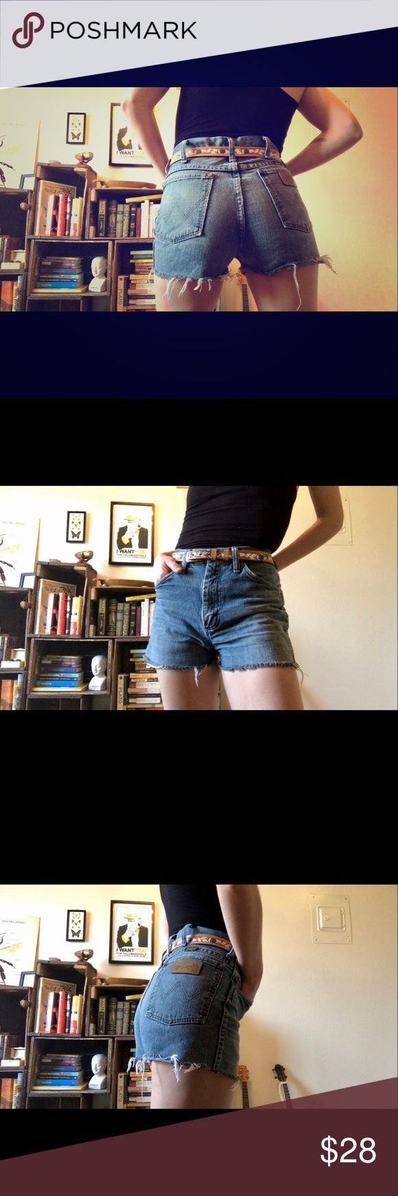 "Vintage Wrangler Custom Cutoffs - Short Shorts Amazing Wrangler cut-offs! High waisted and frayed to perfection in a light blue/grey wash. Last photo shows light separation/ fraying in seam but still sturdy! Waist measures 14"" flat across with 17"" through the hip. 1 1/2 inch inseam. I've never worn them (other than for photos) as they are slightly too big for me. Again, these are not Levi's, they are Wrangler- labeled for the views. Levi's Shorts Jean Shorts"