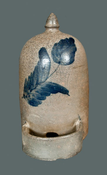 Price Realized: $ 805.00 Extremely Rare Salt-Glazed Stoneware Chicken Waterer with Large Cobalt Floral Design, attributed to R.J. Grier, Chester County, PA, circa 1875, beehive-form with acorn-shaped finial and applied semi-circul
