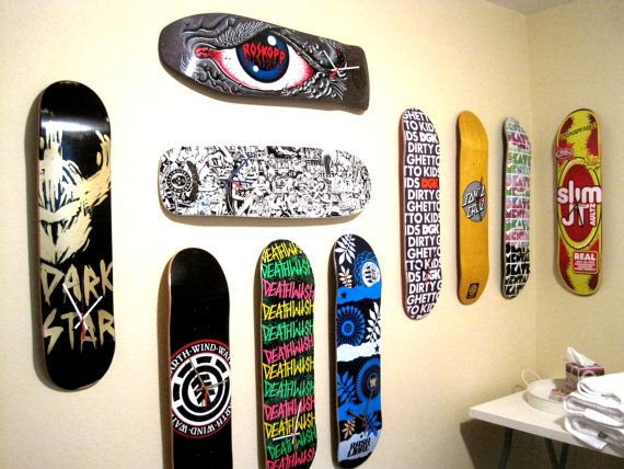 "Skateboard clock... DIY idea for the pile of boards in the bedroom? I think so. ""Neon Green Pink Yellow Graffiti Black Skateboard Deck Clock by GreenBomb, $75.00"""