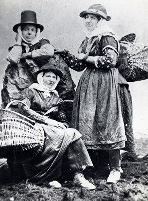 Three cockle women of South Wales, in a posed photograph. They are probably from the coastal village of Llangwm, near Haverfordwest, Pembrokeshire, Dyfed, South Wales. Llangwm cockle women habitually walked their wares to markets and fairs, often as far afield as Carmarthen.
