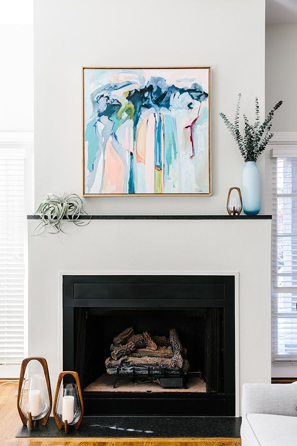 Bold Artwork Above A Modern Fireplace Simple Mantle Styling