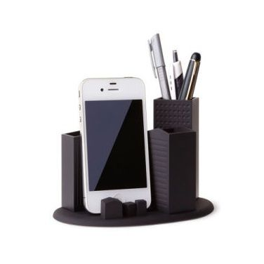 """This is great for your home or work station. Skyline Desk Organizer: A molded desktop organizer in black that patterns after a uniquely urban landscape. The integrated media holder makes it especially tech modern. Size: 6"""" x 4"""" x 4""""."""