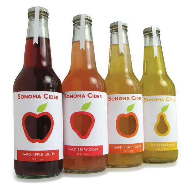 Sonoma Cider Packaging Design: This is a line of hard ciders for the savvy, health-conscious consumer that is interested in the natural ingredients of the product. Fruit die cuts are used on the label to showcase the vibrantly colored beverage indicating the authentic fruits inside. The use of sans serif typeface, simple fruit outlines, and minimal text all contribute to the clean and slightly whimsical design.