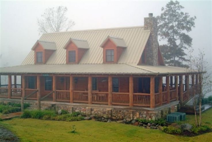 Log home exterior photo 26 homes of character for Full wrap around porch log homes