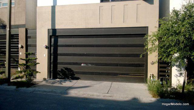 Puerta de garage de herrer a con barras gruesas - Puertas de garage ...