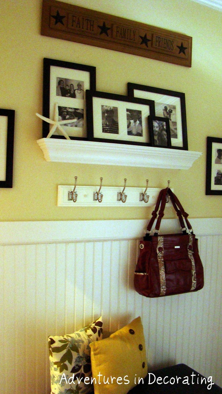 Wanna do something like this in our entry way. Maybe a little seat too. I hate sitting on the dirty stairs to put my shoes on for work. But need the hooks definitely.