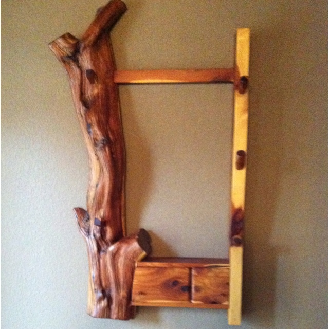 I made this gun rack out of red cedar in shop class in college...it's still one of my favorite pieces in our home!