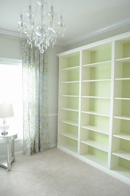 DIY bookcase using IKEA's Billy bookcase. I did this to my Billy's a few years ago. Had my uncle put crown molding on. Looks great!