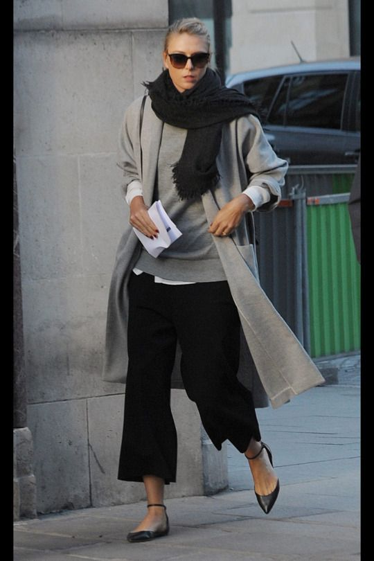 Pointed flats, cropped black trousers, grey jumper, black scarf, overcoat.
