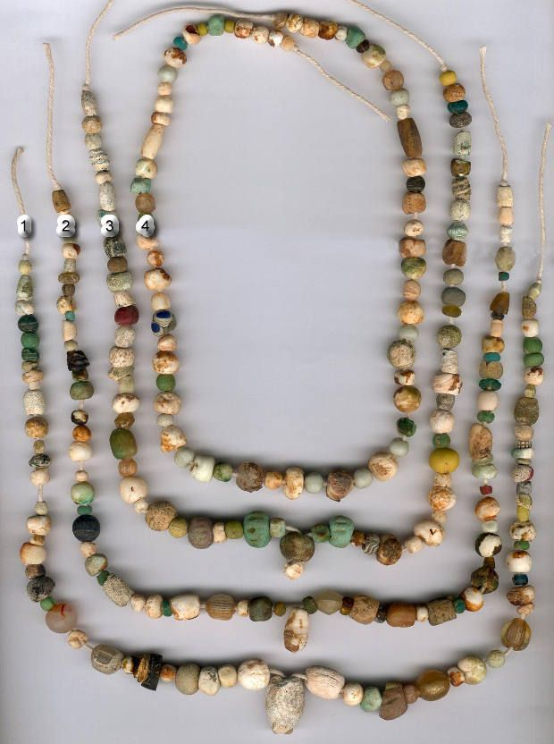 Ancient mixed beads .. found in Afghanistan Including Faience, Gold, Islamic Eyes and other interesting beads ..  in various stages of wear ...