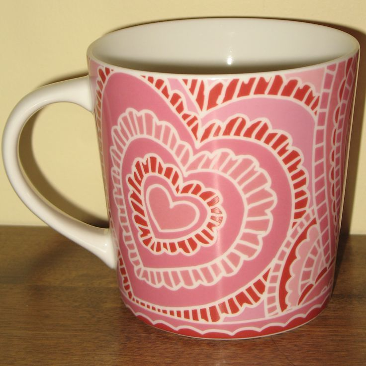 "This pretty-in-pink Starbucks Coffee Mug is one of a pair of definitely very ""girly"" coffee mugs given the color and the hearts! It was created by the Starbucks company in 2005, presumably for Valentine's Day...I love it. How about you? #starbucks #valentinesday"