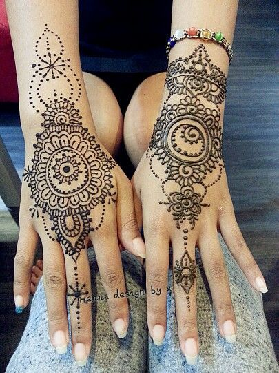 I like the dotted henna shapes spiraling up the arm on the left here.