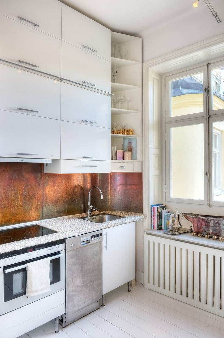 the kitchen, the splash back, the cupboards, heater covers