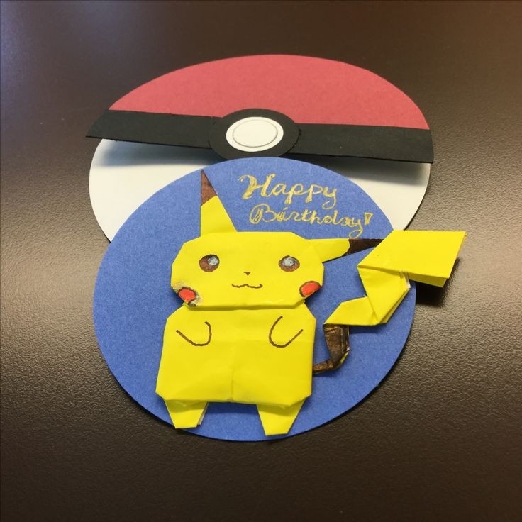 """Origami Pikachu designed by Janessa Munt  (folded by pinner from 4"""" kami) http://www.simonandschuster.com/books/Pokemon-Origami-Fold-Your-Own-Pokemon!/Pikachu-Press/9781604381832  Blue circle: 3"""" punch Freehand b&w Gel pens, brown tombow, red sharpie"""