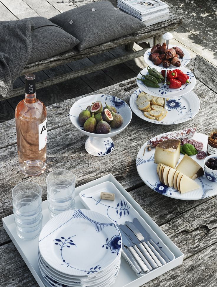 Delicious snacks outside. Kay Bojesen Grand Prix cutlery and Royal Copenhagen Danish Design.