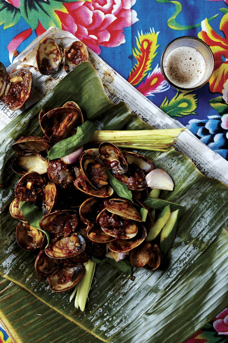 These clams are simply steamed with a fiery, garlicky, smoky, slightly sour sambal.