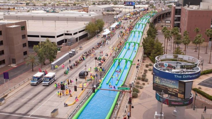 Slide the City coming to Greensboro. Slide the City held more than 80 events in cities across the world last year, including in Phoenix. (Courtesy of Sack Lunch Productions)