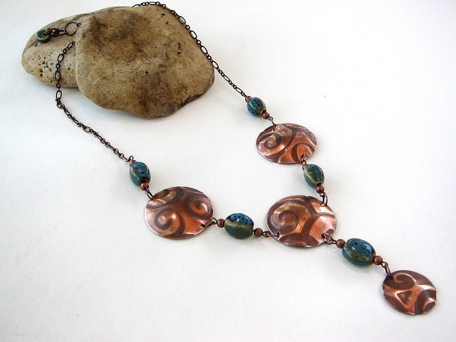 Designs By Alejandra Carazo. Embossed and domed metal with porcelain beads! https://www.facebook.com/DesignsByAlejandraCarazo?ref=bookmarks