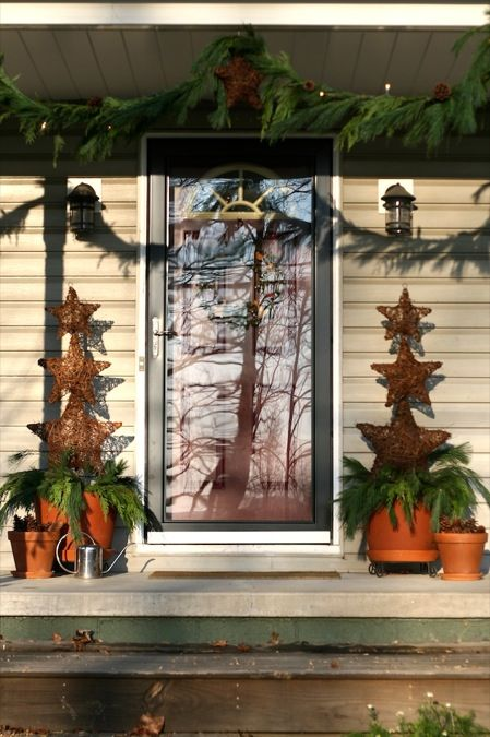 outside christmas decorating ideas | Along with the pine cones I use grapevine stars everywhere. I made ...