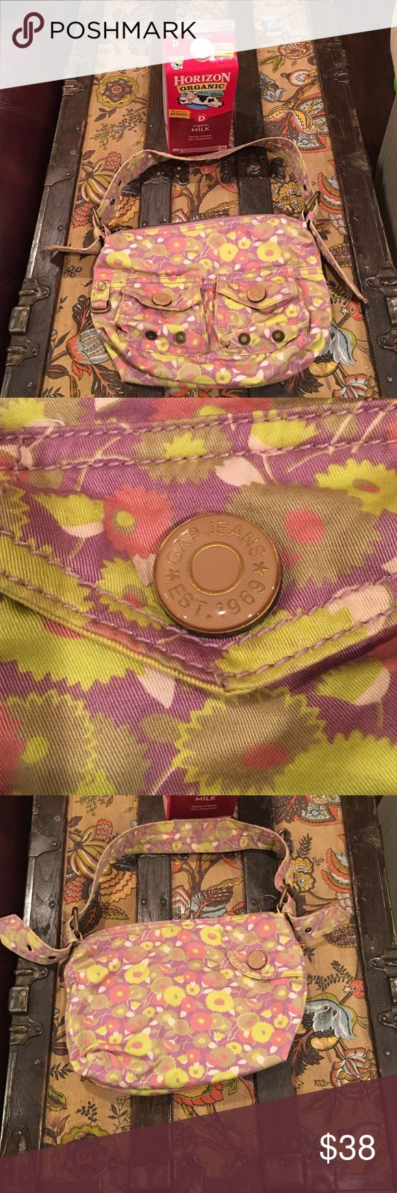 GAP cloth purse w/ brass hardware NWOT Cute flower print GAP Purse 👛 NWOT. I bought it for my daughter & she never used it. Too small for me. It has mustard color lining. Any questions LMK. Used milk carton for size scale. Buckle adjustable strap on both ends 😍💗lavender, pink, tan, yellow soft fabric GAP Bags Satchels