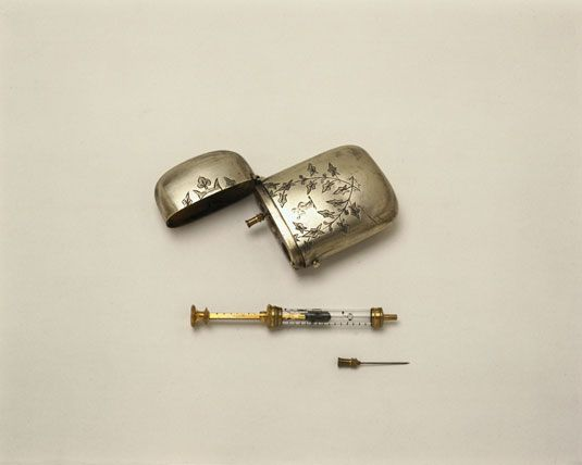 Hypodermic syringe with a spare needle and metal case, late 19th century (perhaps the kind used at 221B Baker St) - currently on display at the Science Museum, South Kensington, London