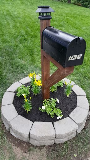 4x4 stained post, mailbox, solar light post topper, retairetaining wallsll blocks, flowers. There you have it; A complete mailbox makeover!