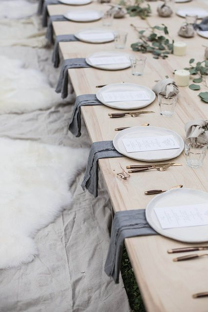 natural tablescape with sheepskin and pale wood