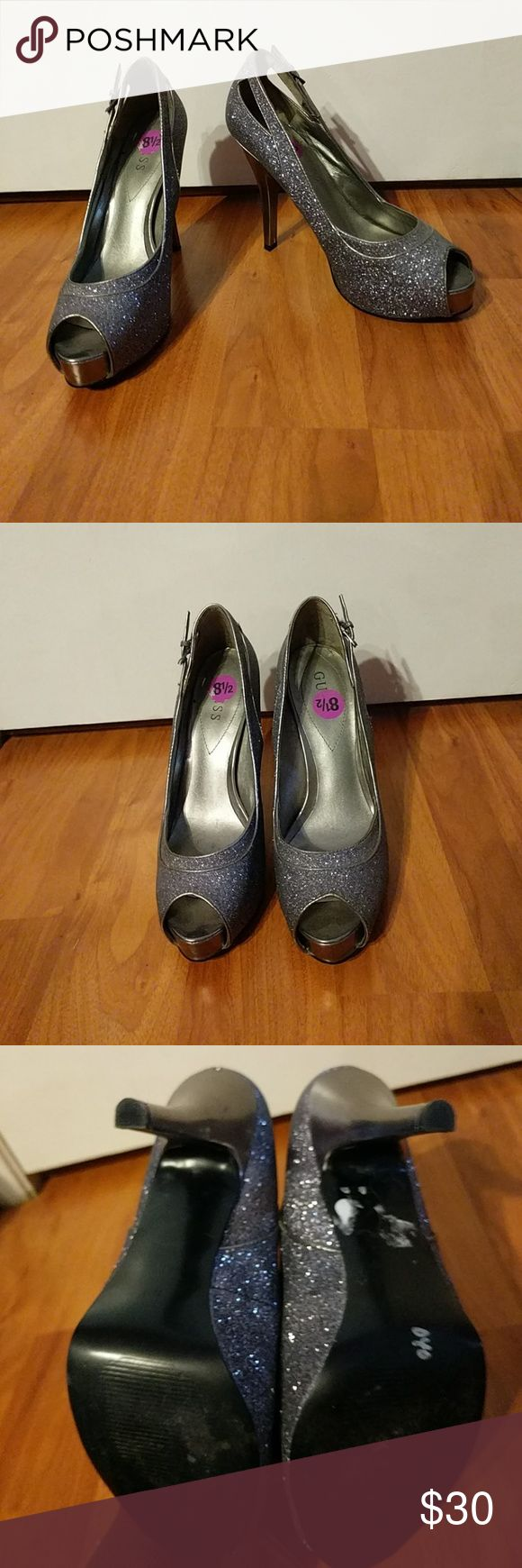 Guess glitter heels Peep toe Guess high heels in a size 8.5. They are a silver glitter with a built in platform and a 5 inch heels. The platform is 1 inch and included in the hell measurements. Guess Shoes Heels