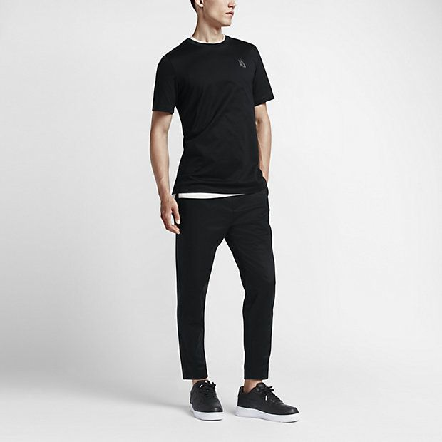 MODERN COMFORT Elevating the iconic tee, the NikeLab Essentials Cotton Men's T-Shirt is designed with an elongated hem ideal for layering or everyday comfort. Benefits Blind stitching on hems lend a crisp, clean look and a smooth feel Durable back neck tape Product Details Fabric: 100% cotton. Machine wash Imported Size and Fit Shown in size medium