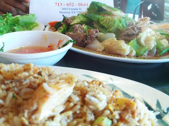 midtown Houston vietnamese restaurant at 2662 Fannin st.   Beef shrimp chicken with vegatables over steamed rice dinner (Good) eleven buck$  Fried rice with chicken, shrimp and beef (Very good) eleven buck$