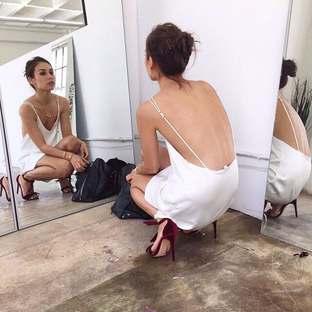 Backless slip dress with pulled up hair.
