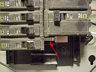 One of two hot bus bars in Square D circuit breaker panel