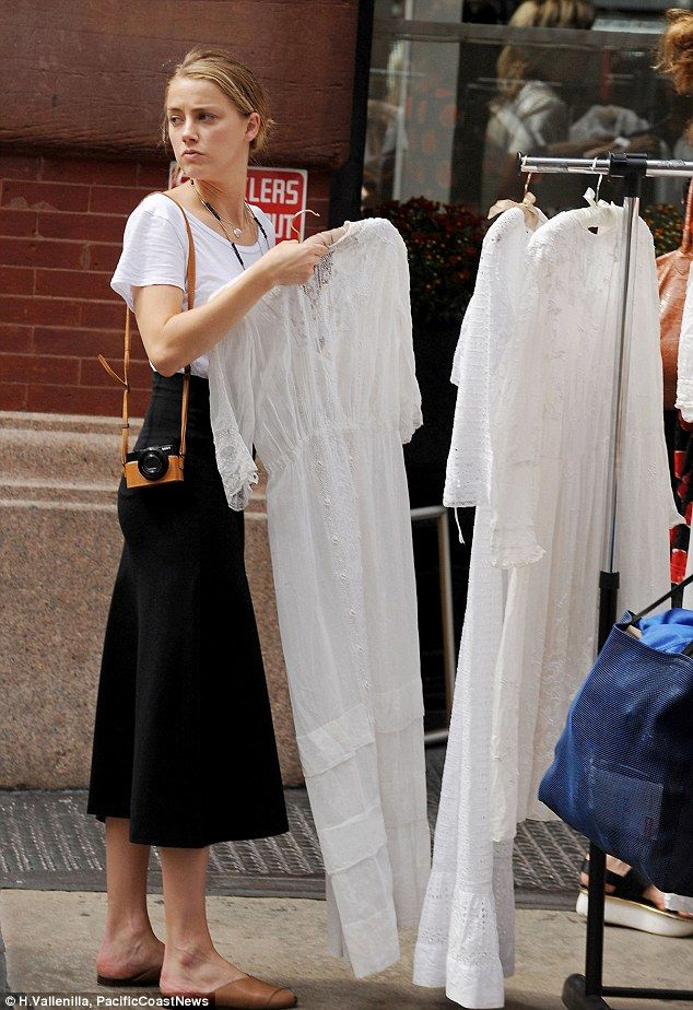 Is that her wedding dress? Amber Heard went make-up free when she shopped at a NYC street vendor where she was seen looking at different white dresses on Monday