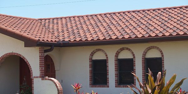 Terra cotta tile roofs are popular on spanish and for Metal roof that looks like spanish tile