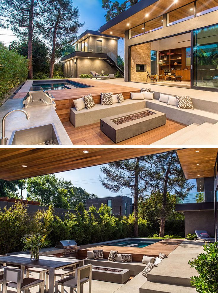 15 Outdoor Conversation Pits Built For Entertaining // This sunken conversation pit tucked right into the deck has a fire pit, bbq and kitchen area, allowing entertaining and and cooking to take place in the same spot.
